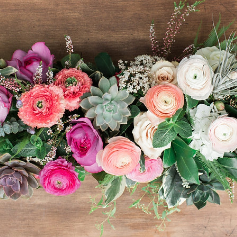 locally grown ranunculus and succulents in a reclaimed wooden box