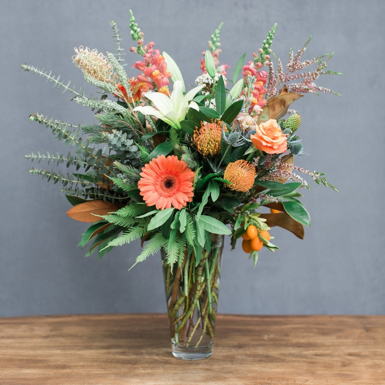 Seasonal, locally grown flowers arranged in a tall angle vase